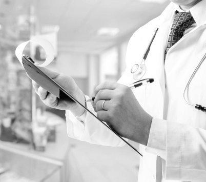 pharmacist writing on his clipboard
