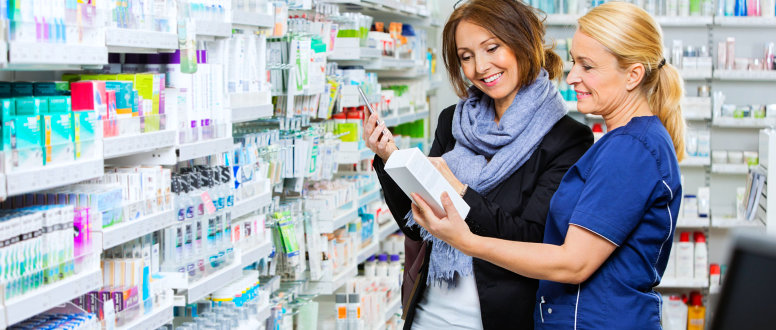 pharmacist helping a customer browse their products