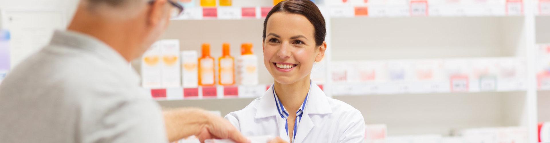pharmacist attending to her customer